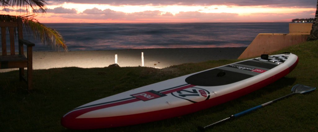 red paddle inflatable sup race board