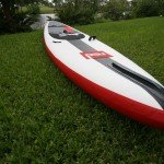Nose fin for shedding water on Red inflatable SUP