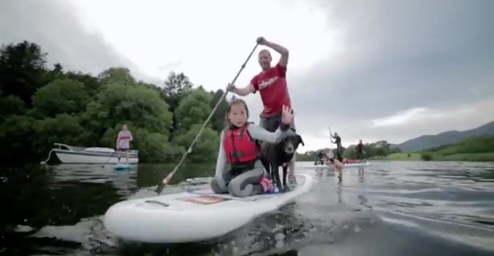 happy family paddle boarding on red paddle co sup