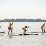 Women racing inflatable paddle boards